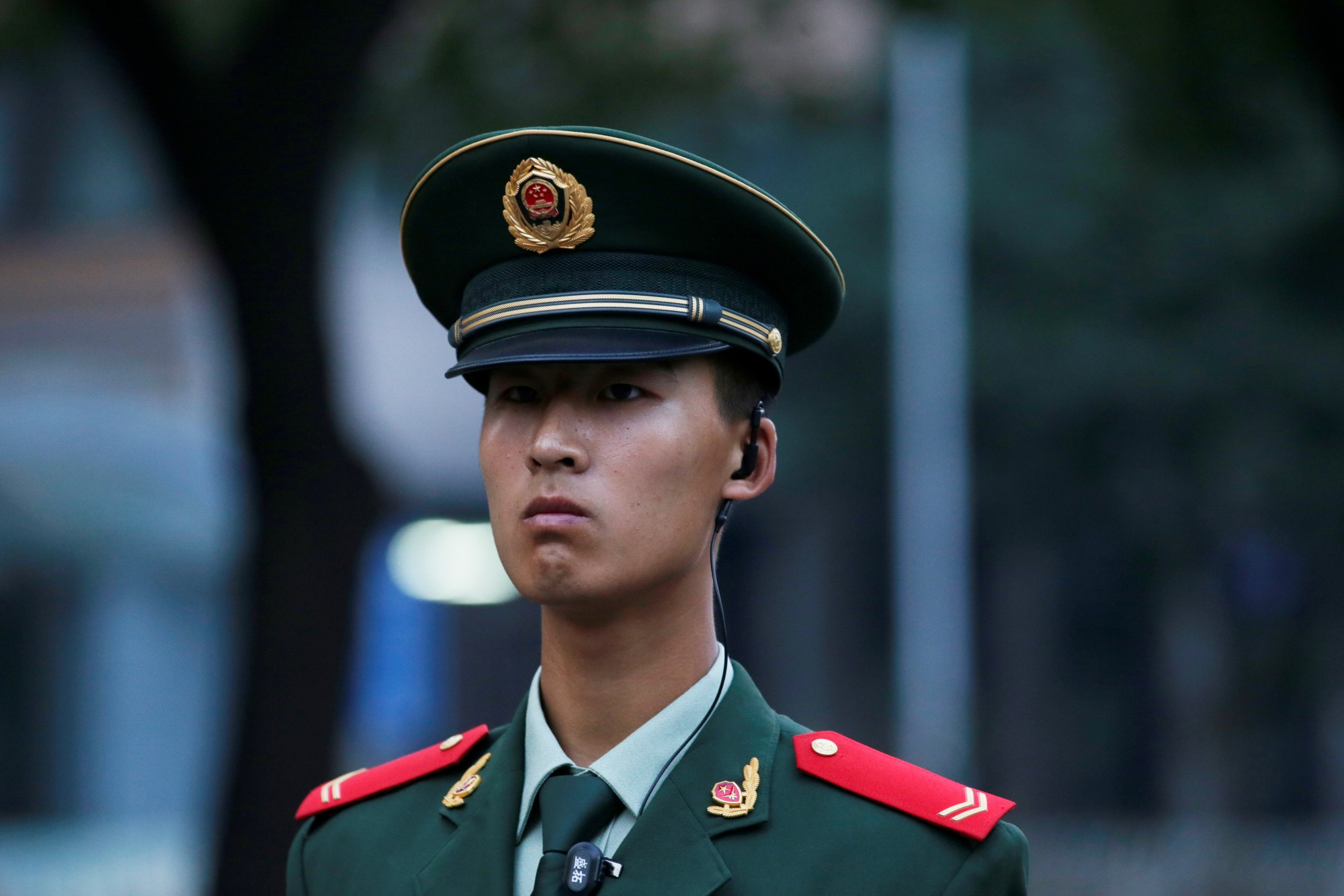 A paramilitary police officer stands guard as streets in central Beijing were closed off for a rehearsal of the military parade on October 1 to mark the 70th anniversary of the founding of the People's Republic of China, in Beijing, China September 21, 2019. REUTERS/Stringer