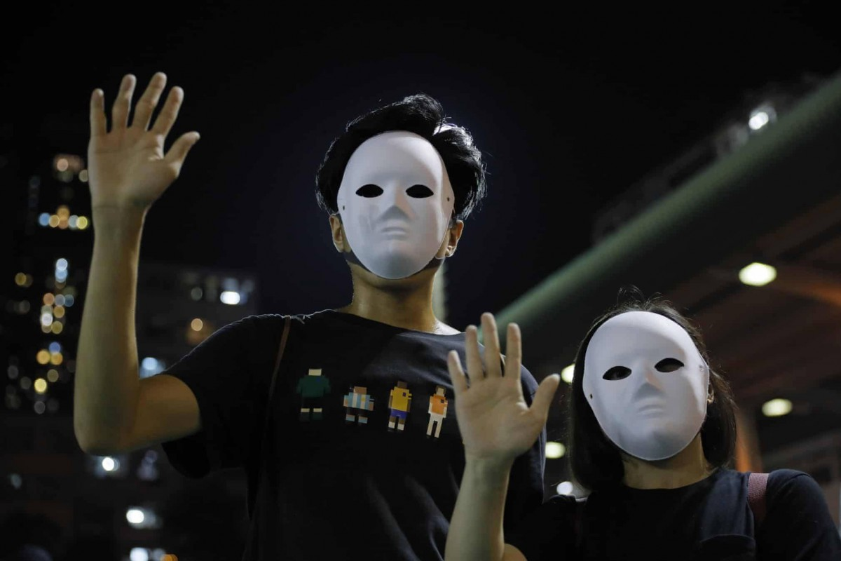 Masked protestors hold up their hands to represent their five demands during Saturday's rallies in Hong Kong. Picture taken on October 7th, 2019, The Guardian, Kin Cheung / AP