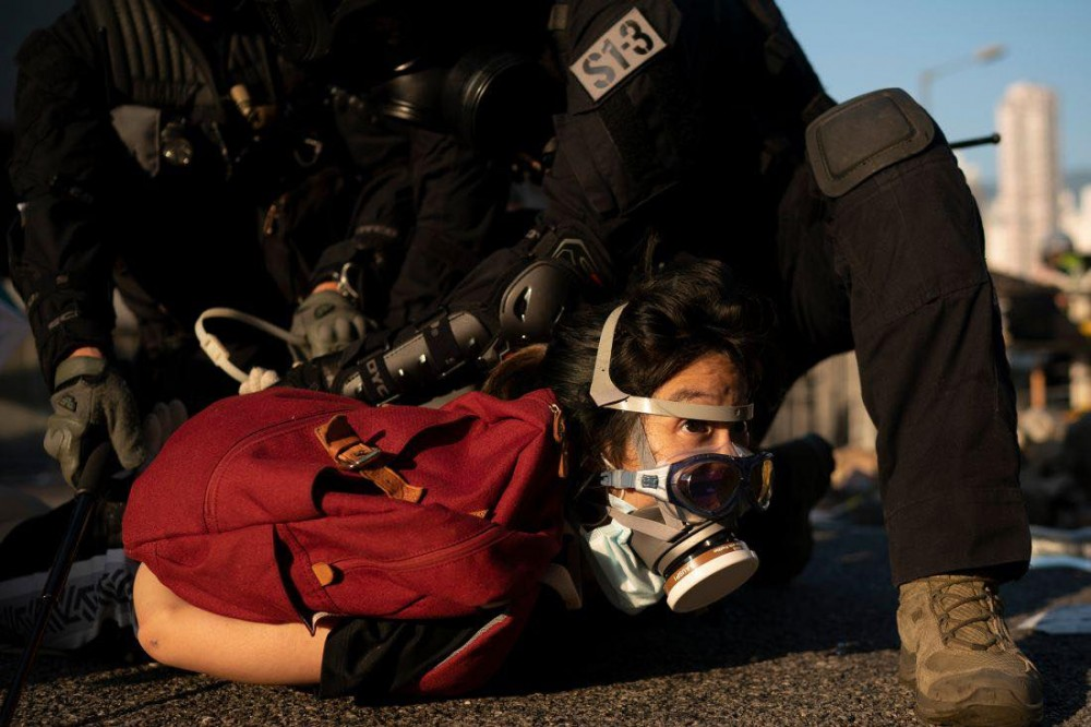 A young woman is arrested during the protests of Saturday October 5th Taken from CNN, October 6th, 2019