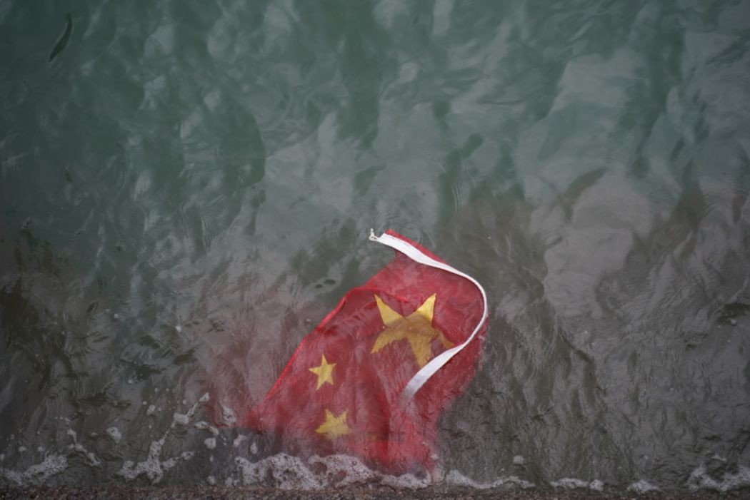 Cover Image Chinese flag tossed- inmedia.net