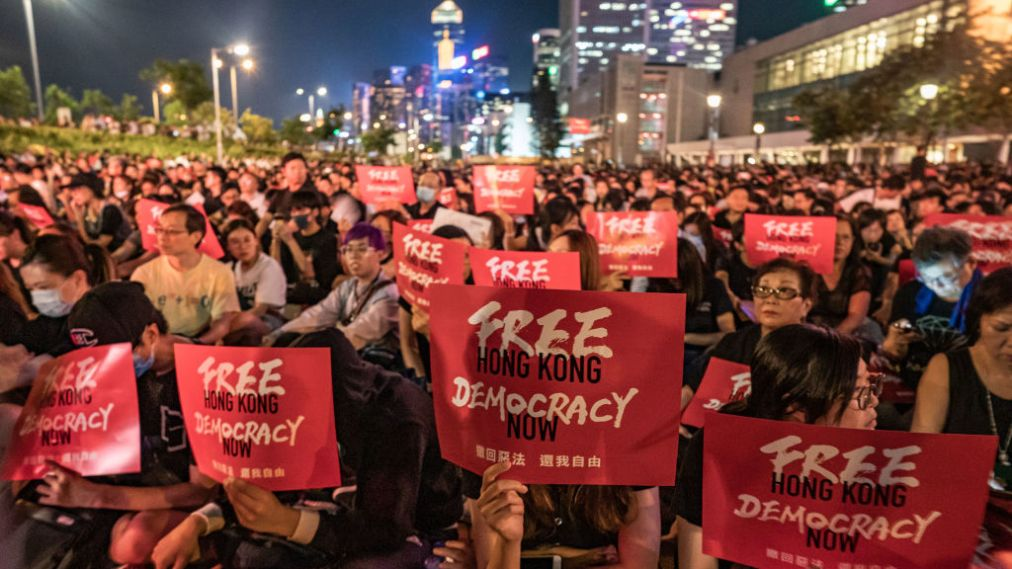 HONG KONG, HONG KONG - JUNE 26: Protesters hold placards as they take part in a rally against the extradition bill ahead of 2019 G20 Osaka summit at Edinburgh Place in Central district on June 26, 2019 in Hong Kong, China. (Photo by Anthony Kwan/Getty Images)