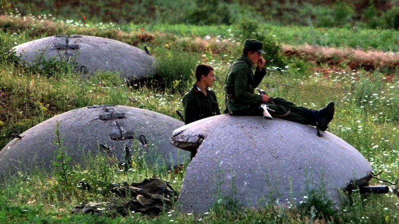 Albanian Army soldiers sit atop their bunkers near the Albanian-Yugoslav border in Morina on Thursday, 3 June 1999. [EPA/ANJA NIEDRINGHAUS]